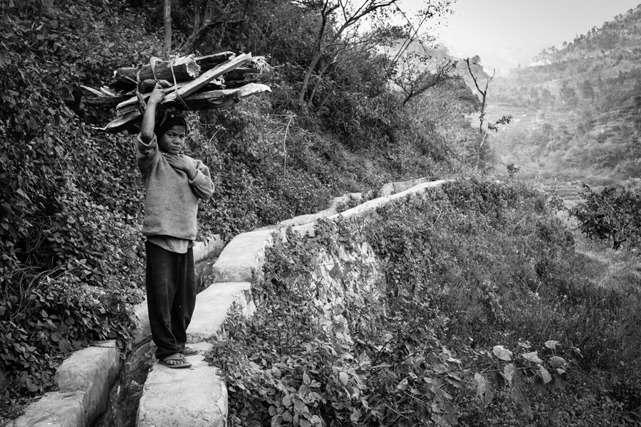 I encountered this boy while hiking while hiking high in the mountains just north of Rishikesh. He navigated the winding mountain paths, balancing a bundle of firewood on his head, and wearing flip-flops. The reservoir channel upon which he is standing is the only route to his home. At his bequest, I followed him to his family's abode.