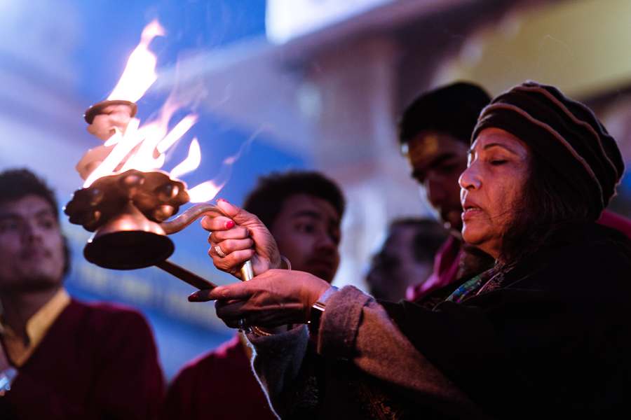 "Aarti literally means ""remover of darkness"" and the ceremony involves circulating an Aarti plate or Aarti lamp. This act serves as a symbol of devotion to and sublimation with the divine light. It is customary for Aarti participants to hold their hands to the fire or fire lamp and then rub their faces and bodies with the ""light."" This practice represents purification of the self through sublimating the self, which may have dark aspects, into the illumining nature of the divine."