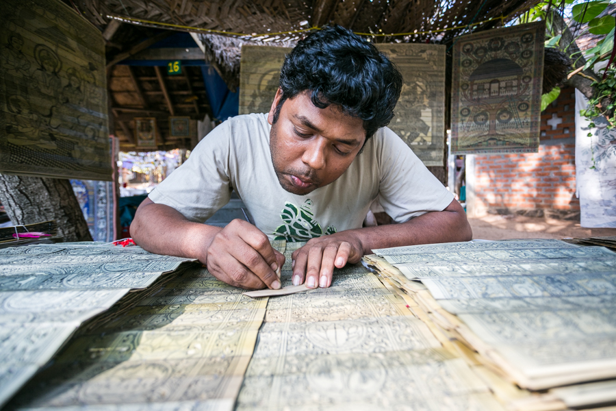 Prakash, an artist from Odisha, an eastern Indian state on the Bay of Bengal. The method of engraving palm leaves with ink has been practiced by his family for seven generations.