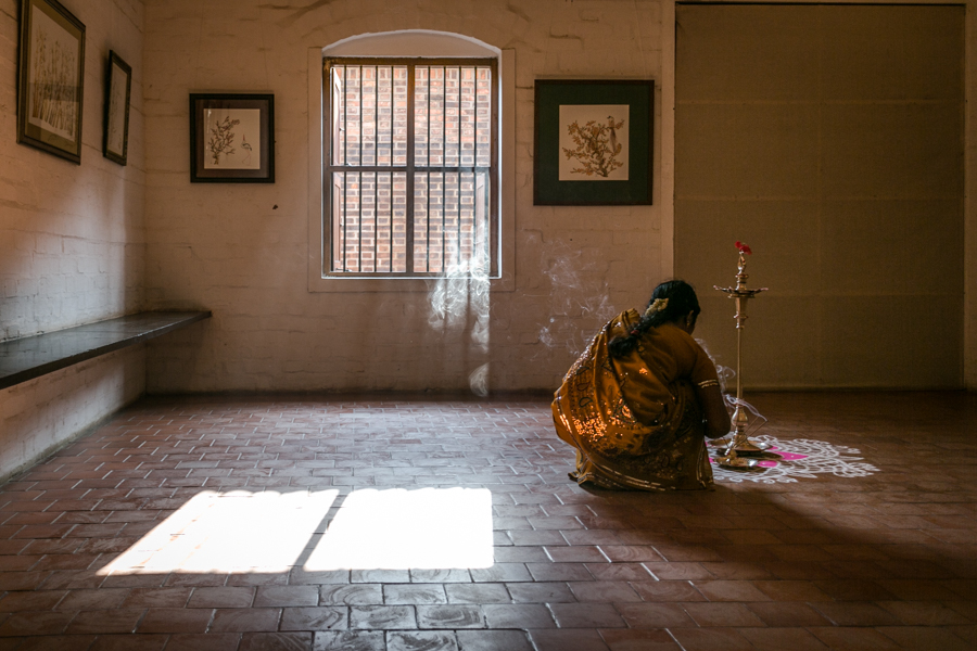 Women preparing for a ceremonial aarti (a fire ritual) in honor of a new exhibit by artist Ashesh Joshi.