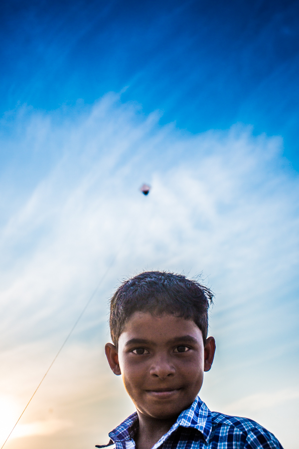 Boy flying kite at the Marina Beach in Chennai.