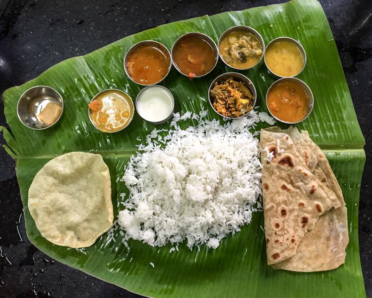Thali served on banana leaf.