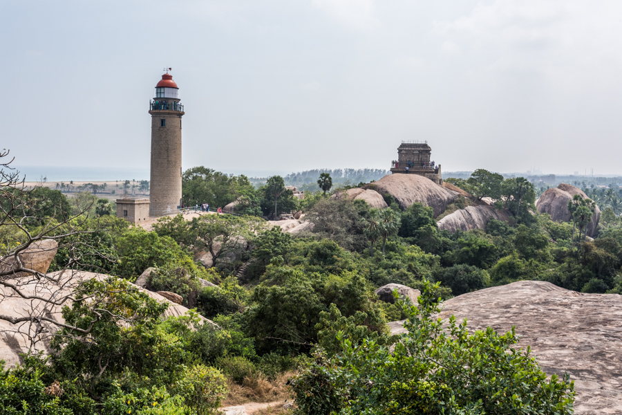 Mamallapurmal Hill features many archaeological sites sprawled throughout the rock-strewn terrain. The lighthouse on the left, functional since 1904, is now a tourist attraction. The square structure to the right of the lighthouse is the Olakaneeswara Temple dedicated to lord Shiva. It was also used as a lighthouse by the British until the modern structure was completed. Standing adjacent to the British-built lighthouse is India's oldest lighthouse, built around 640 AD by Pallava king Mahendra Pallava.