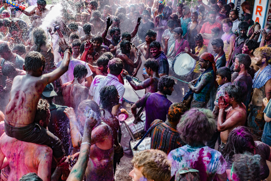 Holi revelers in Hampi.I nitially, Holi was celebrated by creating a bonfire and then the next day, when the fire had cooled down, people would apply ash to their foreheads. Eventually, color powder replaced ash and the color festival was born.