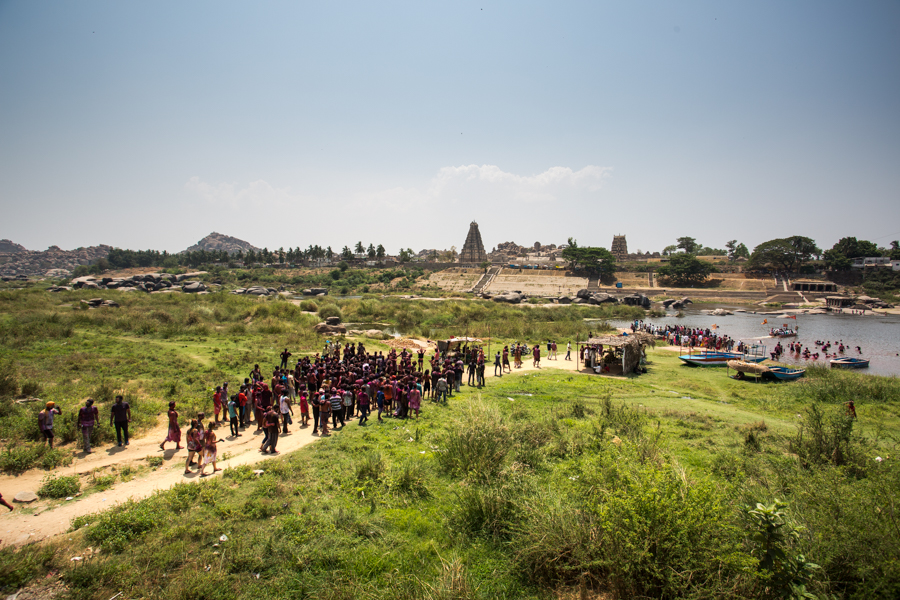 Holi participants heading to the river for a rinse, taking inspiration from the resident elephant of Hampi's Virupaksha Temple (seen on the far bank -- the temple that is) who bathes in the river every morning.