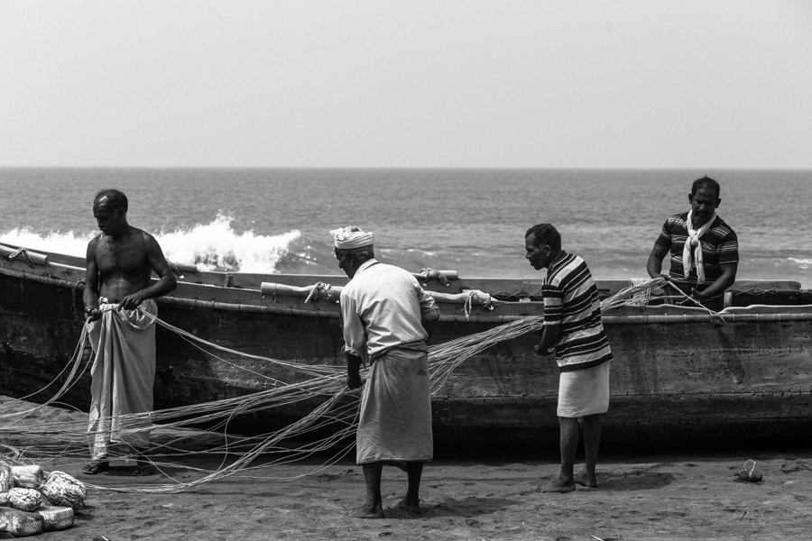 Varkala fisherman folding their nets.