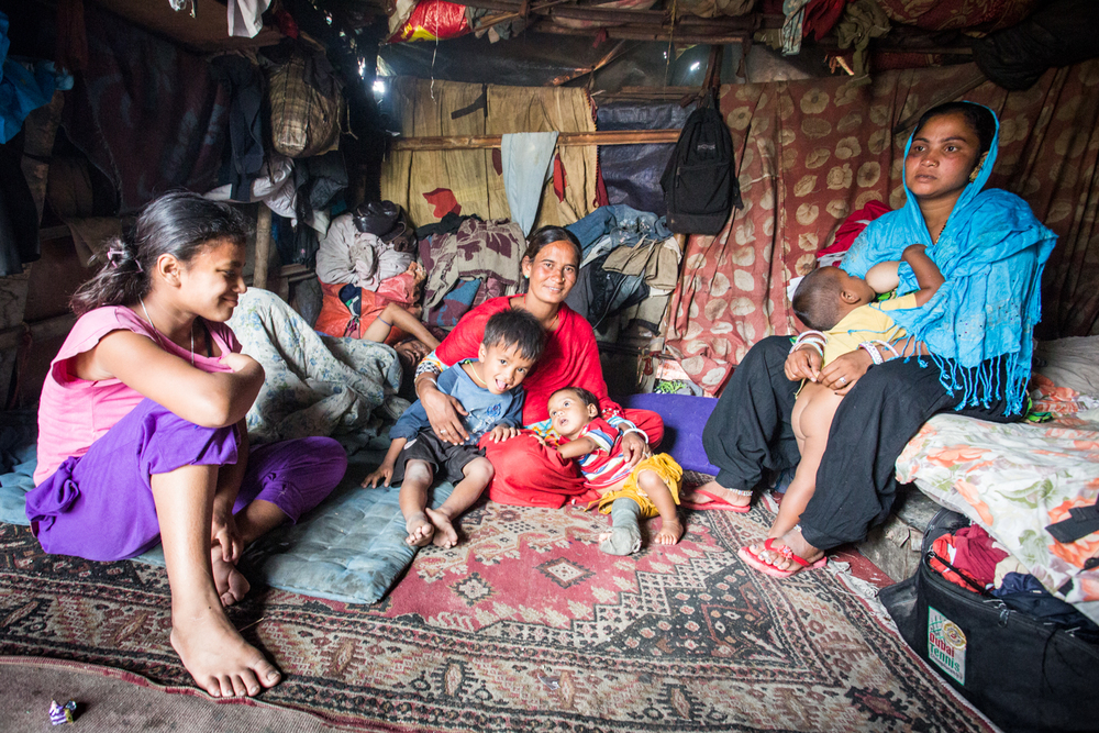 Rajasthani immigrants inside their makeshift home erected in an unused field in Kathmandu. This family will be the subject on a future piece on women and the begging economy.