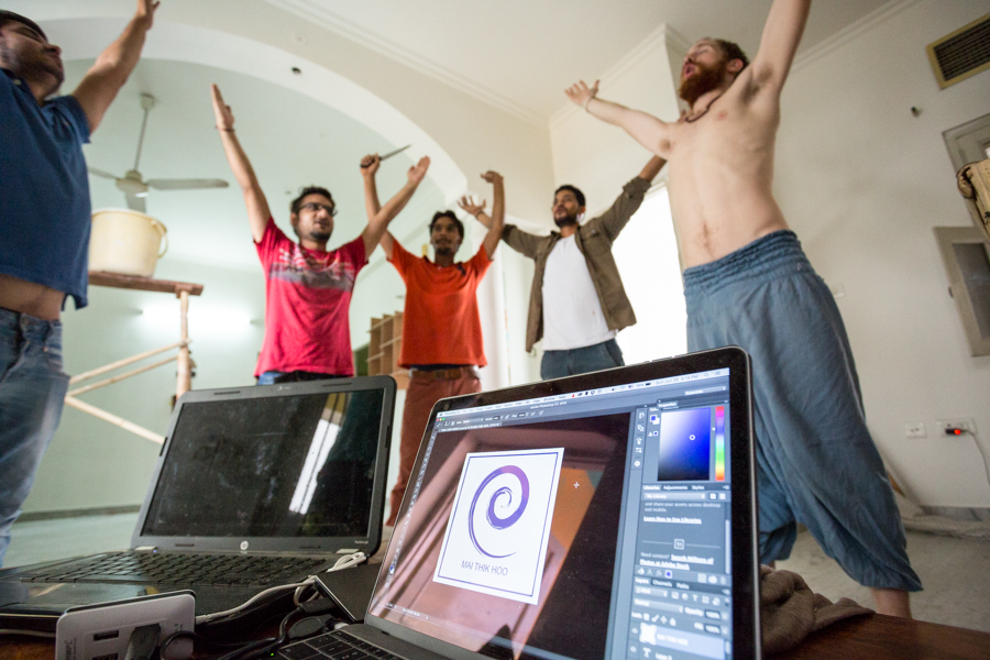 Members of Mai Thik Hoo taking a power-pose after finalizing a logo design. We ultimately eschewed the design, deciding that the spiral was trite.