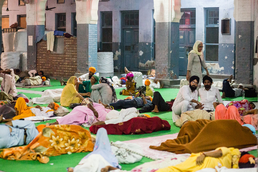Pilgrims at the Golden Temple. The Temple accommodates thousands of pilgrims every week. There is even a special dormitory reserved for foreign travelers.
