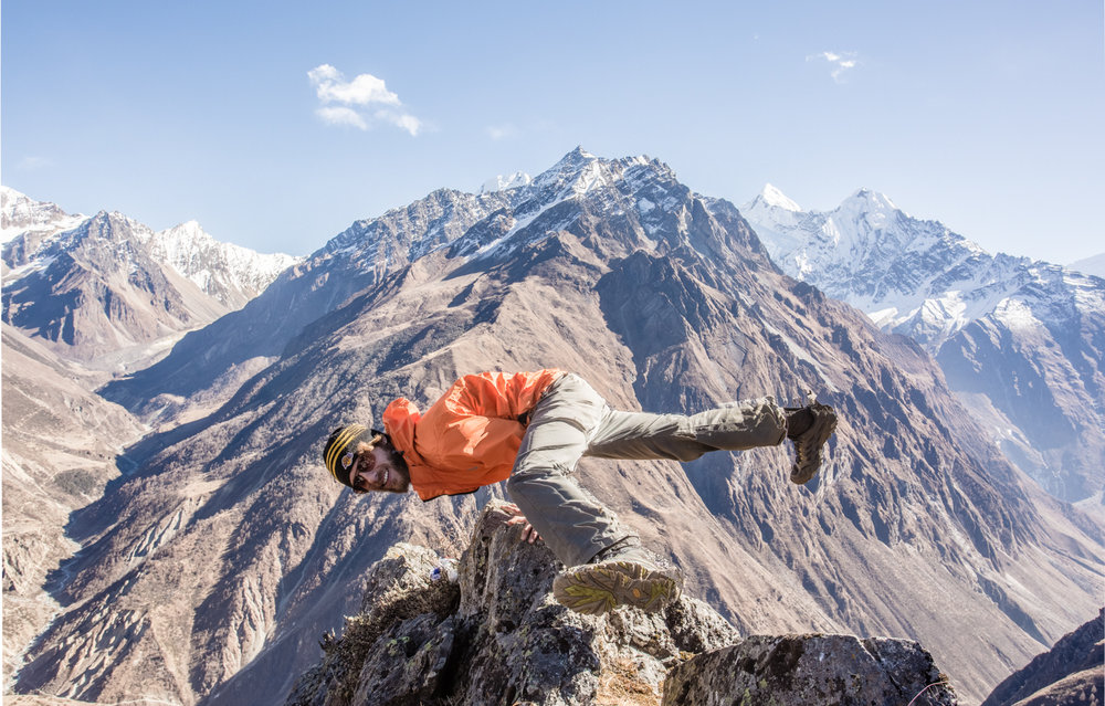"Popping a yoga pose in front the Ganesh (""elephant"") massif, which border Tsum to the east. Photograph by Rob Fuldner."
