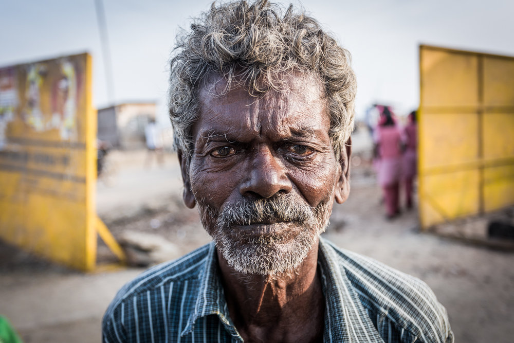 "An older man or ""uncle"" (as Indians call their unrelated elders) photograped in the Marina slum of Chennai, India."
