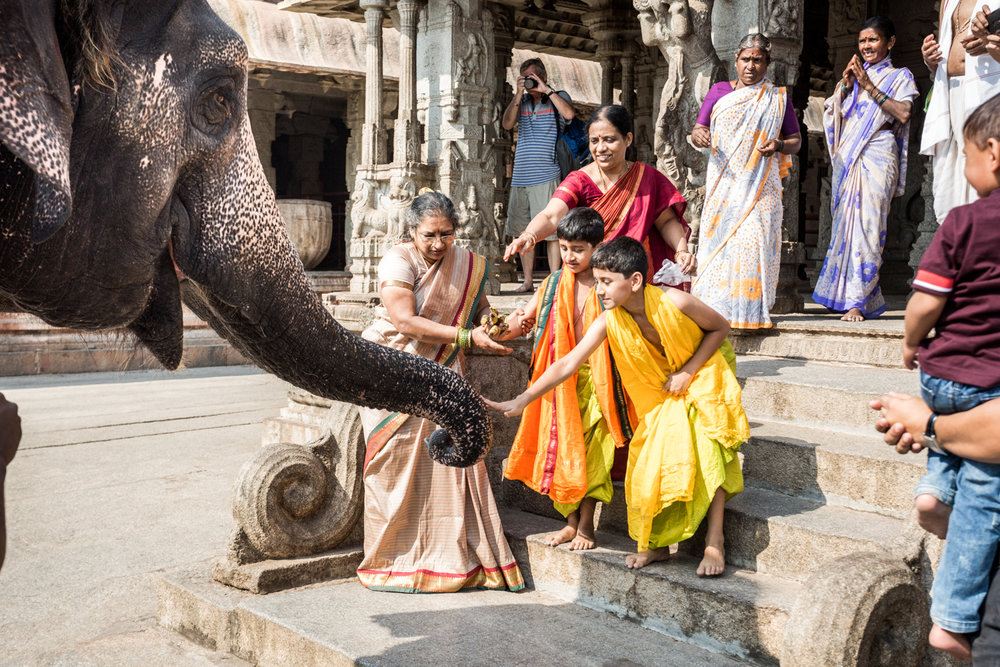 Virupaksha Temple in Hampi. The elephant is trained to take temple donations in the form of coins.