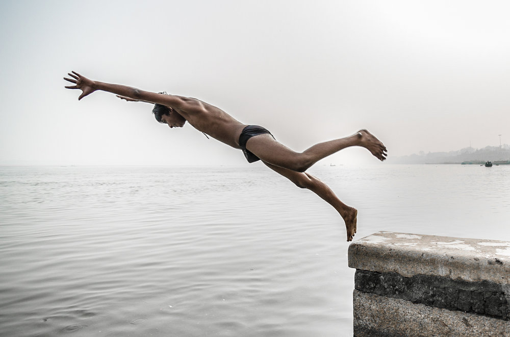 Boy jumping into the Ganges in Varanasi.
