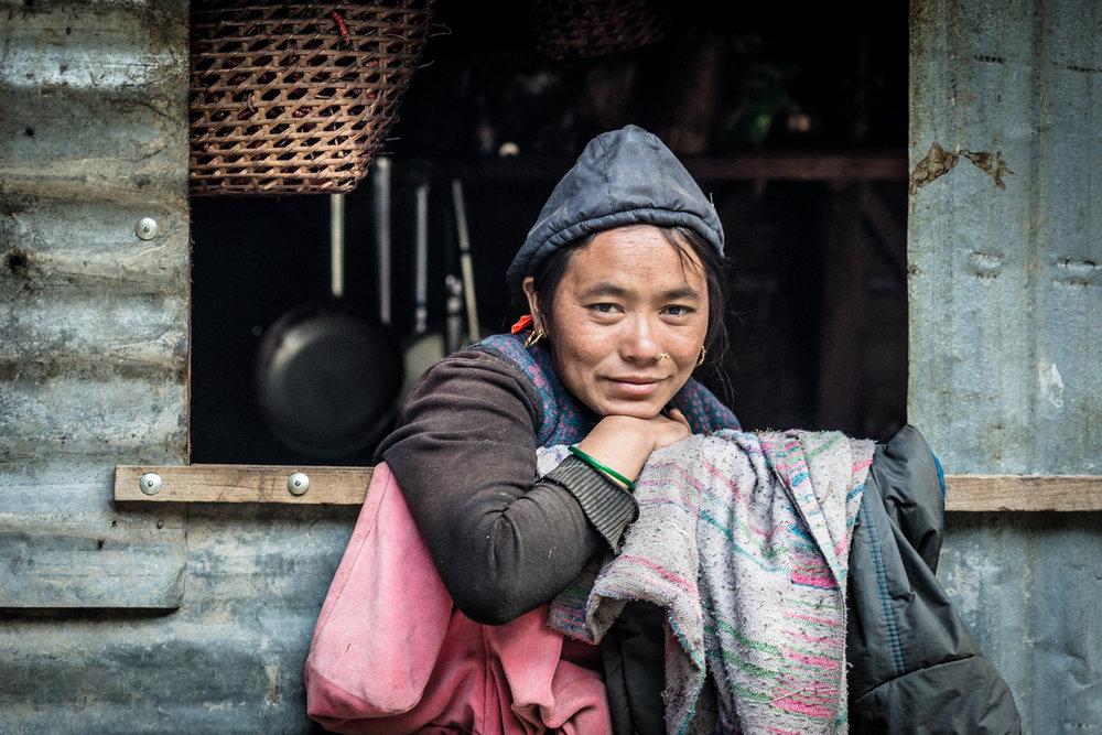 An ethnic Tibetan woman inside her teashop, Manaslu Reserve.