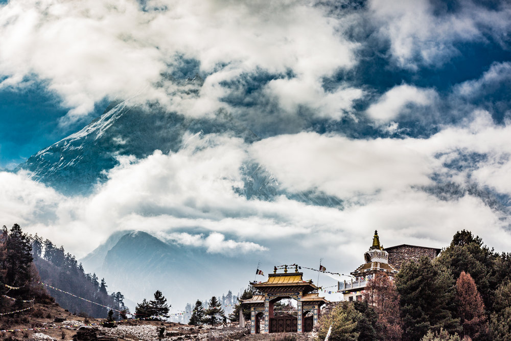 Ribum, a Buddhist monastery, is perched against the backdrop of Manaslu, the eighth highest mountain in the world.