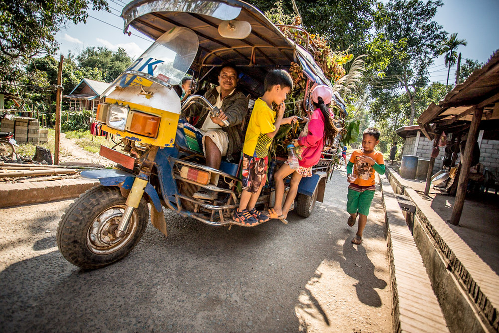 A party tuk-tuk in Xieng Men, a village opposite the Mekong River from Luang Prabang.