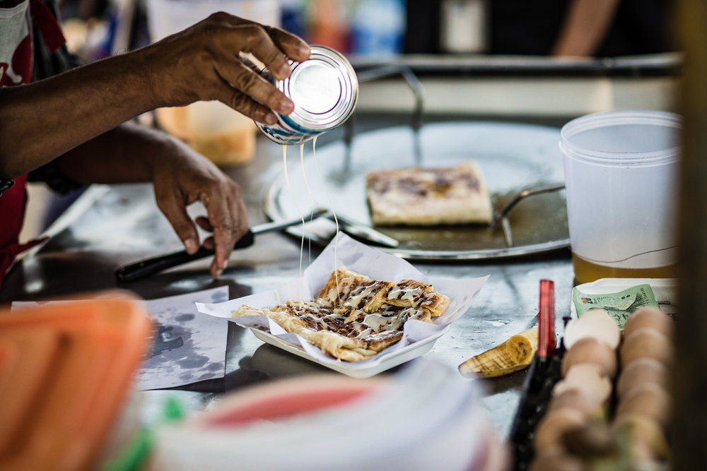 Roti pancakes—filled with egg and banana, and topped with condensed milk or powdered sugar—are a popular street food are a popular street snack in Thailand.