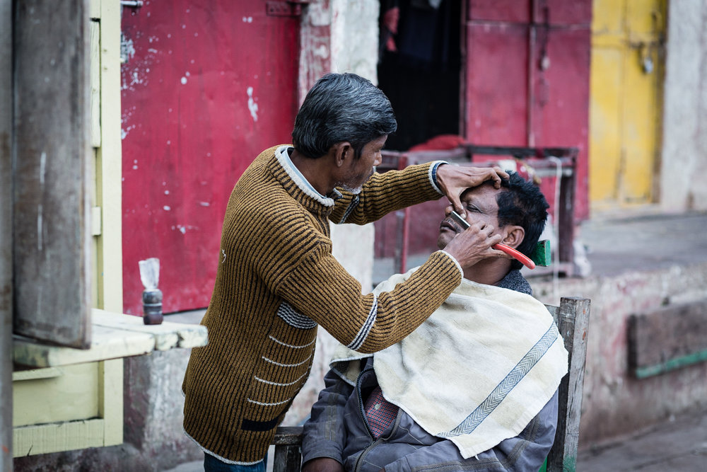 Street barbers are a quintessential element of Indian culture. Varanasi.