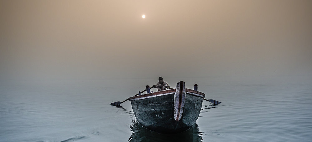 Boatman on the Ganges River, near the main ghats of Varanasi.