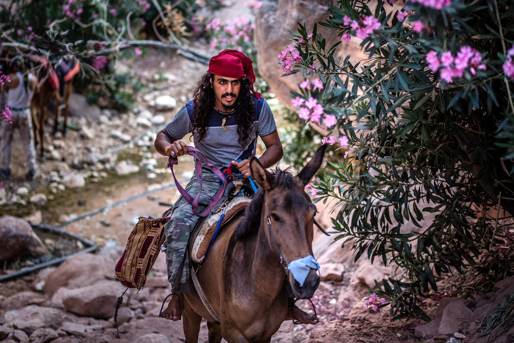 "Faraj returning from taking his horse for a drink at a ""secret"" creek."