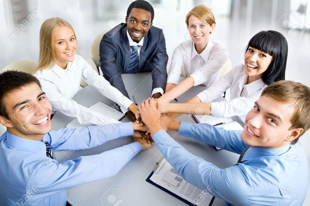 19562781-Business-people-working-together-A-diverse-work-group--Stock-Photo.jpg