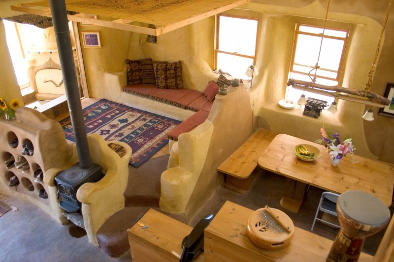 Raised Living Room with storage underneath earthen floor, earthen plastered Strawbale walls.jpg