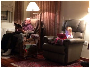 Arcuda (with book) Grandchild Lily (with iPad)