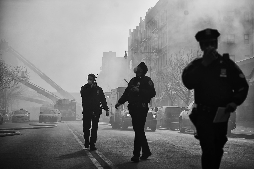 Police officers respond to the scene of a fifth-alarm fire in Harlem at 116th & Park Avenue on Wednesday, Mar. 12, 2014 in New York, N.Y. The gas explosion killed eight people and injured dozens more, including at least eight children, and reduced two five-story buildings at 1644 and 1646 Park Ave. to rubble.