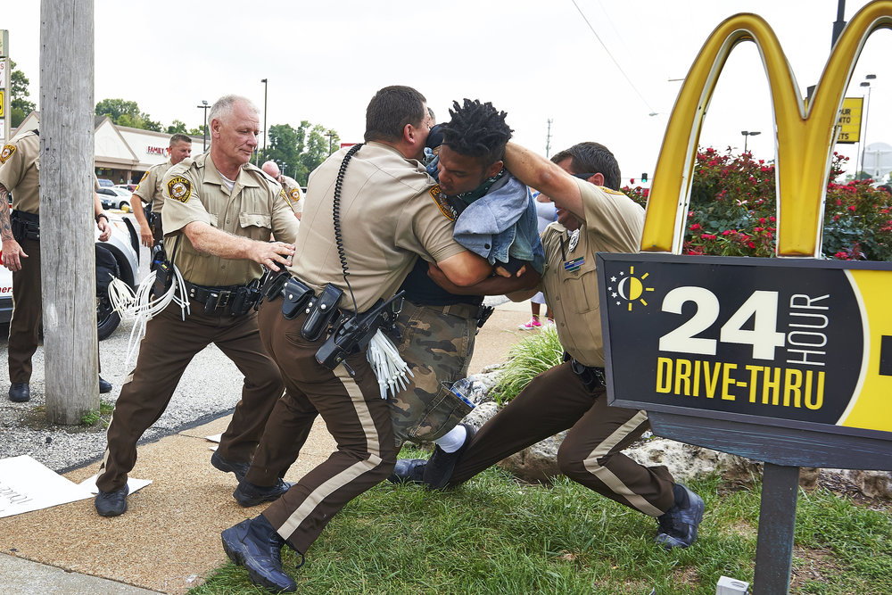 Demonstrators protest Michael Brown fatal shooting