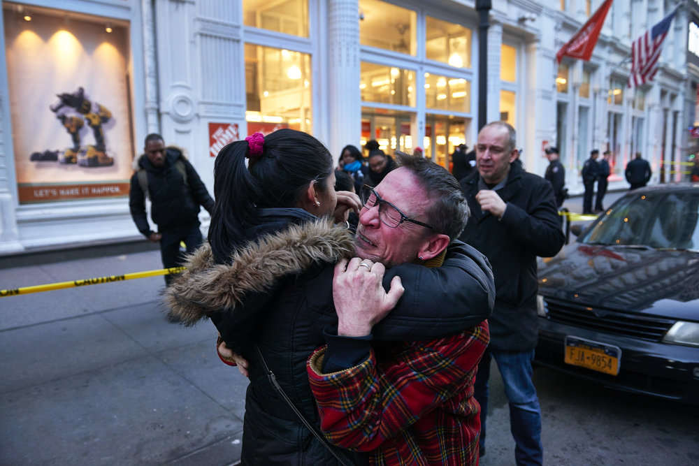 A Home Depot employee reacts after two men were shot dead at a Home Depot store on Sunday, January 25, 2015 in New York, N.Y.