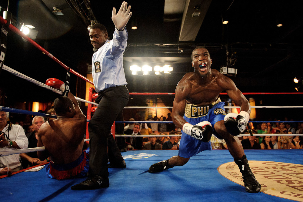 Phillip Jackson Benson, right,reacts after knocking out Alexander Santana during a DiBella Entertainment - Broadway Boxing super middleweight bout at BB King Blues Club & Grill in New York, N.Y.
