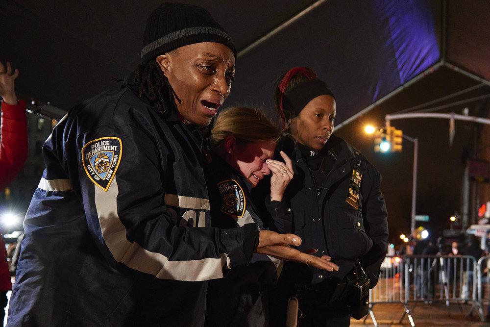 New York Police Department visit a memorial for 84th precinct New York Police Department officers Rafael Ramos and Wenjian Liu on Monday, Dec. 22, 2014 in Brooklyn, N.Y.
