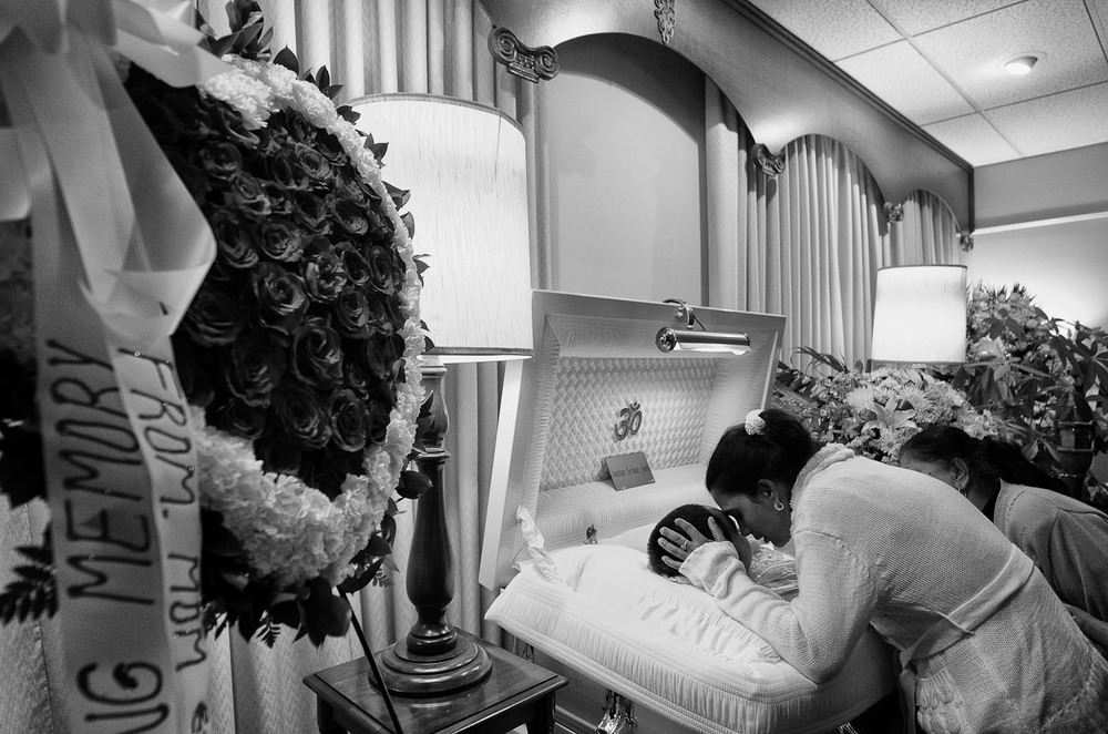Angela Jewth holds her son Jonathan Jewth, 9, at the conclusion of his wake at the Thomas C. Montera, Inc. Funeral Home on Dec. 16, 2011, in the Bronx, N.Y. The fourth-grader choked after eating a meatball during lunch at Public School 47 in the Bronx.