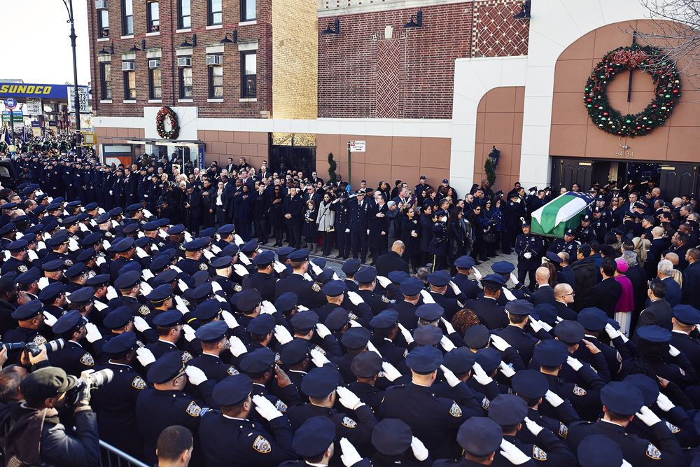 The casket of New York Police Department officer Rafael Ramos leaves Christ Tabernacle Church following his funeral on Saturday, Dec. 27, 2014 in Queens, N.Y.