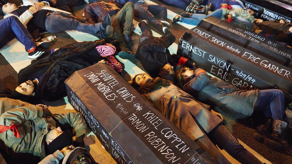 "Demonstrators stage a ""die-in"" on Atlantic Avenue after marching across the Brooklyn Bridge to protest a Staten Island grand jury's decision not to indict the NYPD officer involved in the chokehold death of Eric Garner on Thursday, Dec. 4, 2014 in New York, N.Y."