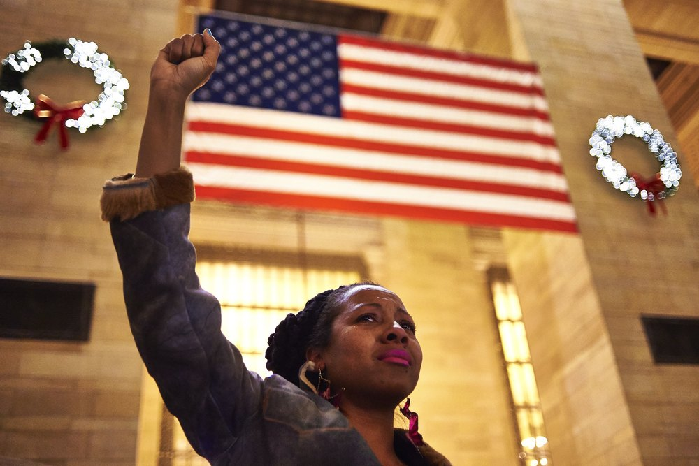 Cecily Witcher, of Brooklyn, joined demonstrators at Grand Central Terminal to protest a Staten Island grand jury's decision not to indict the NYPD officer involved in the chokehold death of Eric Garner on Monday, Dec. 8, 2014 in New York, N.Y.