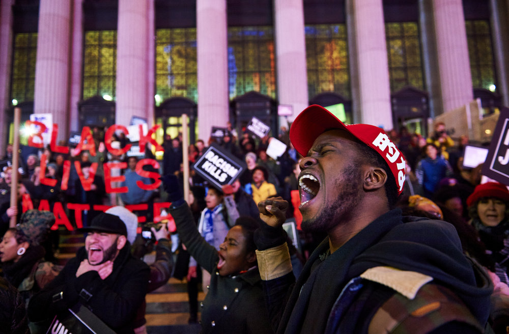 Demonstrators gather in front of the James A. Farley Post Office Building to protest a Staten Island grand jury's decision to not indict the NYPD officer involved in the chokehold death of Eric Garner on Monday, Dec. 8, 2014 in New York, N.Y.