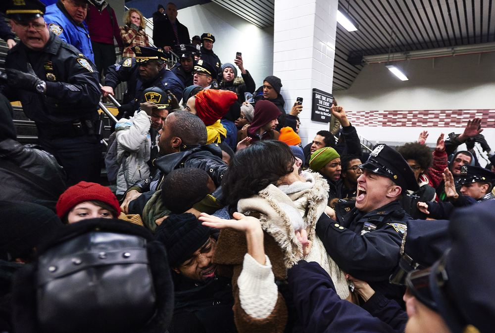 "Demonstrators clash with New York Police Department police officers in the Atlantic Avenue – Barclays Center subway station following a ""die-in""  to protest a grand jury's decision not to indict NYPD officer Daniel Pantaleo in the choking death of Eric Garner on Monday, Dec. 8, 2014 in Brooklyn, N.Y."