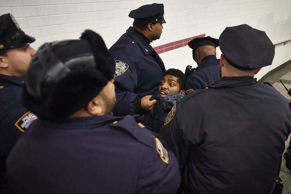 New York Police Department make an arrest as demonstrators faced off against officers in the Atlantic Avenue – Barclays Center subway station as Prince William and Kate Middleton attended a Nets-Cavaliers game on Monday, Dec. 8, 2014 in Brooklyn, N.Y. The royal couple's courtside appearance coincided with a die-in in the streets of Brooklyn to protest a Staten Island grand jury's decision to not indict NYPD officer Daniel Pantaleo in the choking death of Eric Garner.