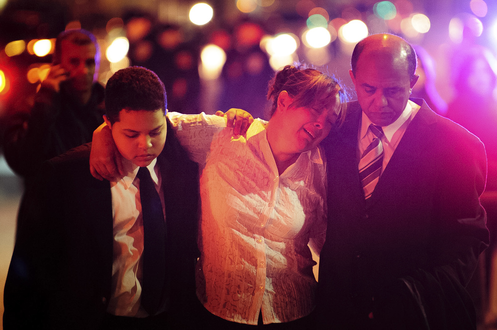 Mourners leave a wake at the Parkchester Funeral Home on May 5, 2013, in the Bronx, N.Y., for three generations of a Bronx family who died  when a speeding SUV carrying seven people — including three little girls — vaulted off an overpass and plunged 60 feet into the Bronx Zoo, killing everyone in the car.