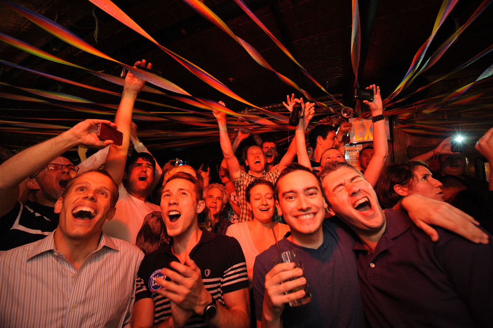 People at the Stonewall Inn in the West Village react after New York's Senate approved a gay marriage bill on June 24, 2011 in New York.