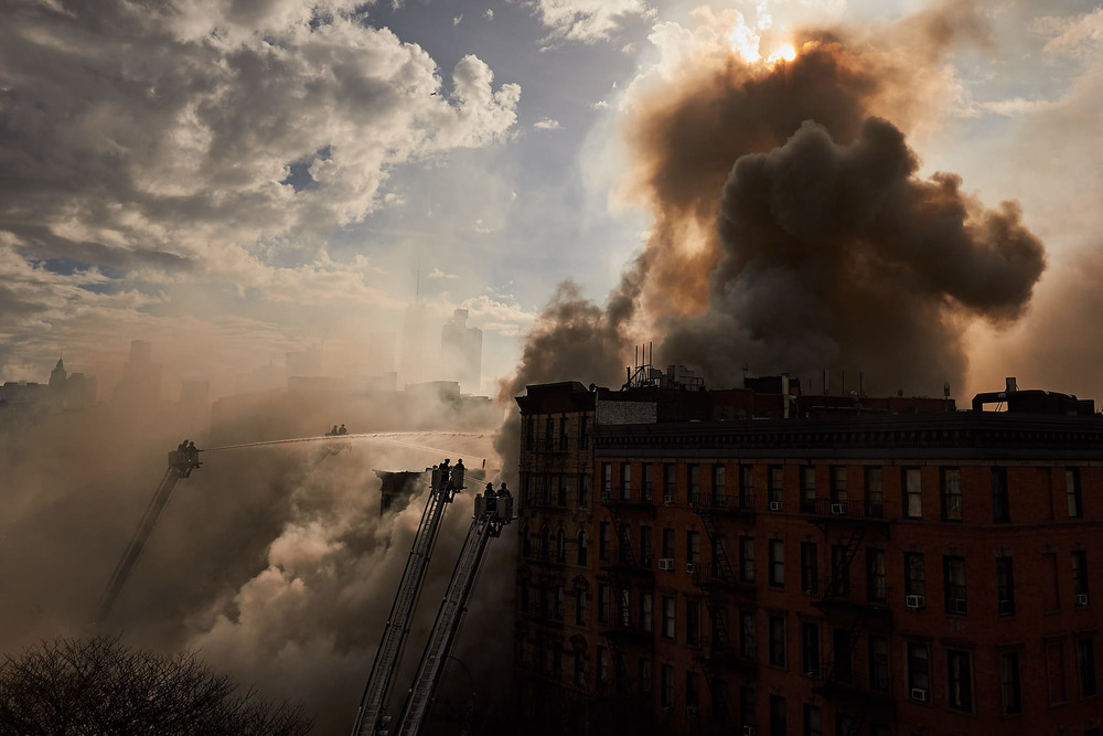 An East Village building collapsed after it was rocked by a thunderous blast and devoured by a fierce fire that spread to neighboring structures and sent black smoke into the sky on Thursday, Mar. 26, 2015 in New York, N.Y.