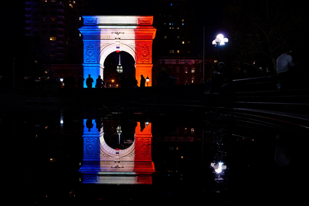 The Washington Square Park Arch is lit up with the colors of the French flag to honor the 130 victims of the Paris terrorist attacks on Nov. 15, 2015.