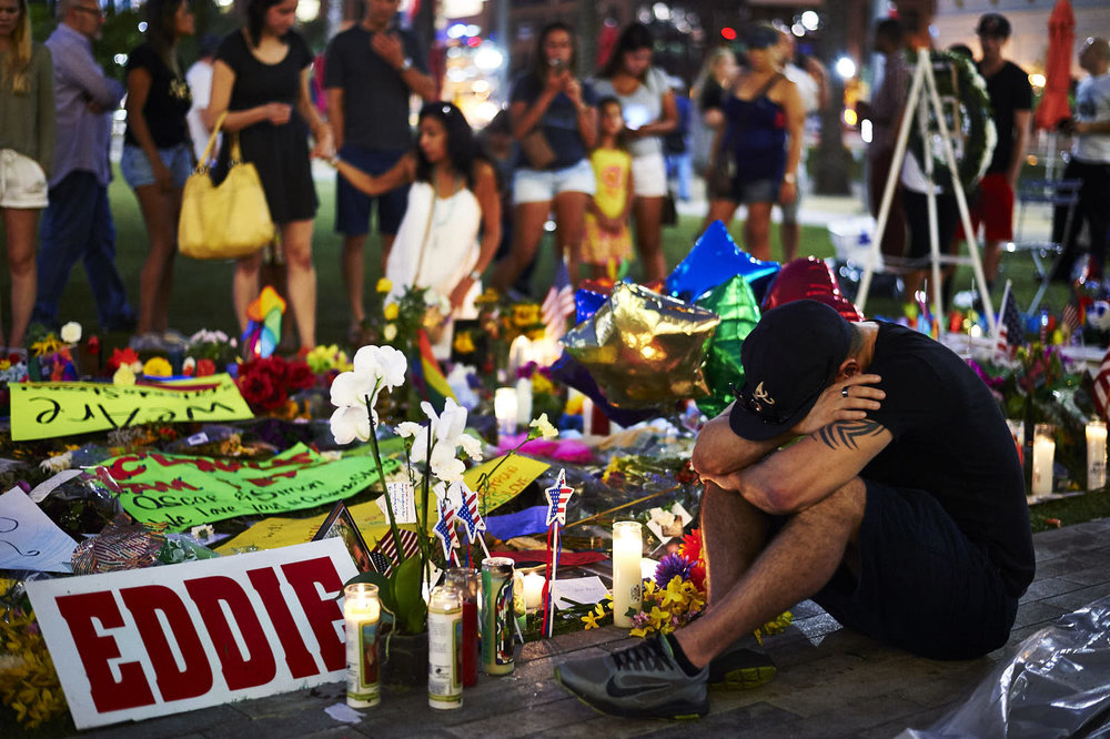 Jean Dasilva, of Orlando, Fla., mourns the death of his friend Javier Jorge-Reyes, at a makeshift memorial at Dr. Phillips Center for the Performing Arts for victims of the Pulse nightclub mass shooting at  on Tuesday, June 14, 2016 in Orlando, Fla.
