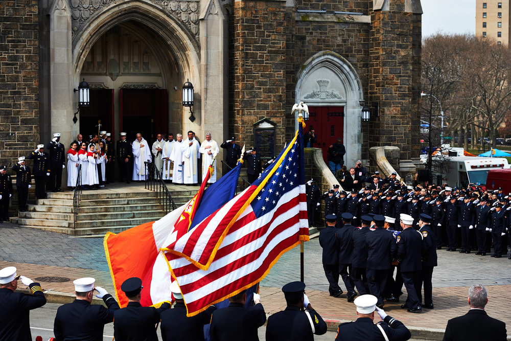 Pallbearers carry the casket of fallen Fire Department of the City of New York Emergency Medical Technician Yadira Arroyo into St. Nicholas of Tolentine Roman Catholic Church during her funeral on Saturday, March 25, 2017 in the Bronx, N.Y. Arroyo was driving an ambulance when Jose Gonzalez, a violent, schizophrenic criminal, jumped inside and tried to drive off — instead running her over twice and killing her.