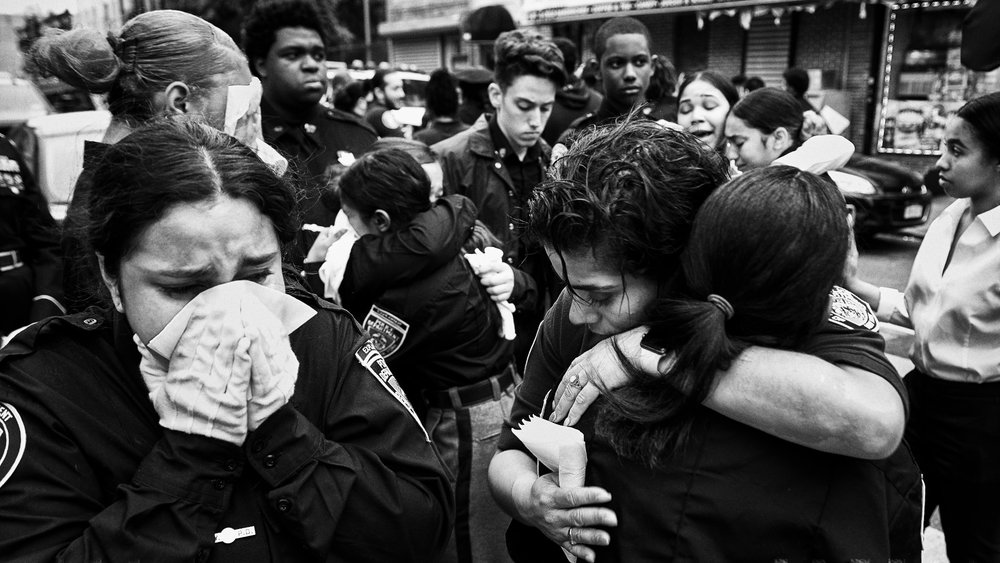 Members of the New York Police Department's Law Enforcement Explorers program console each other following the funeral of stabbing victim Lesandro Guzman-Feliz, 15, at Our Lady of Mt. Carmel Church on Wednesday, June 27, 2018 in the Bronx, N.Y. Guzman-Feliz was a member of the Explorers.
