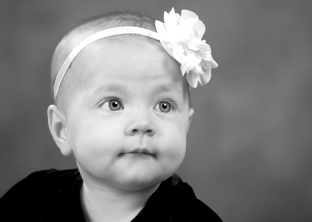 baby girl child portrait photography cute bow studio portraits west bridgford vale of belvoir