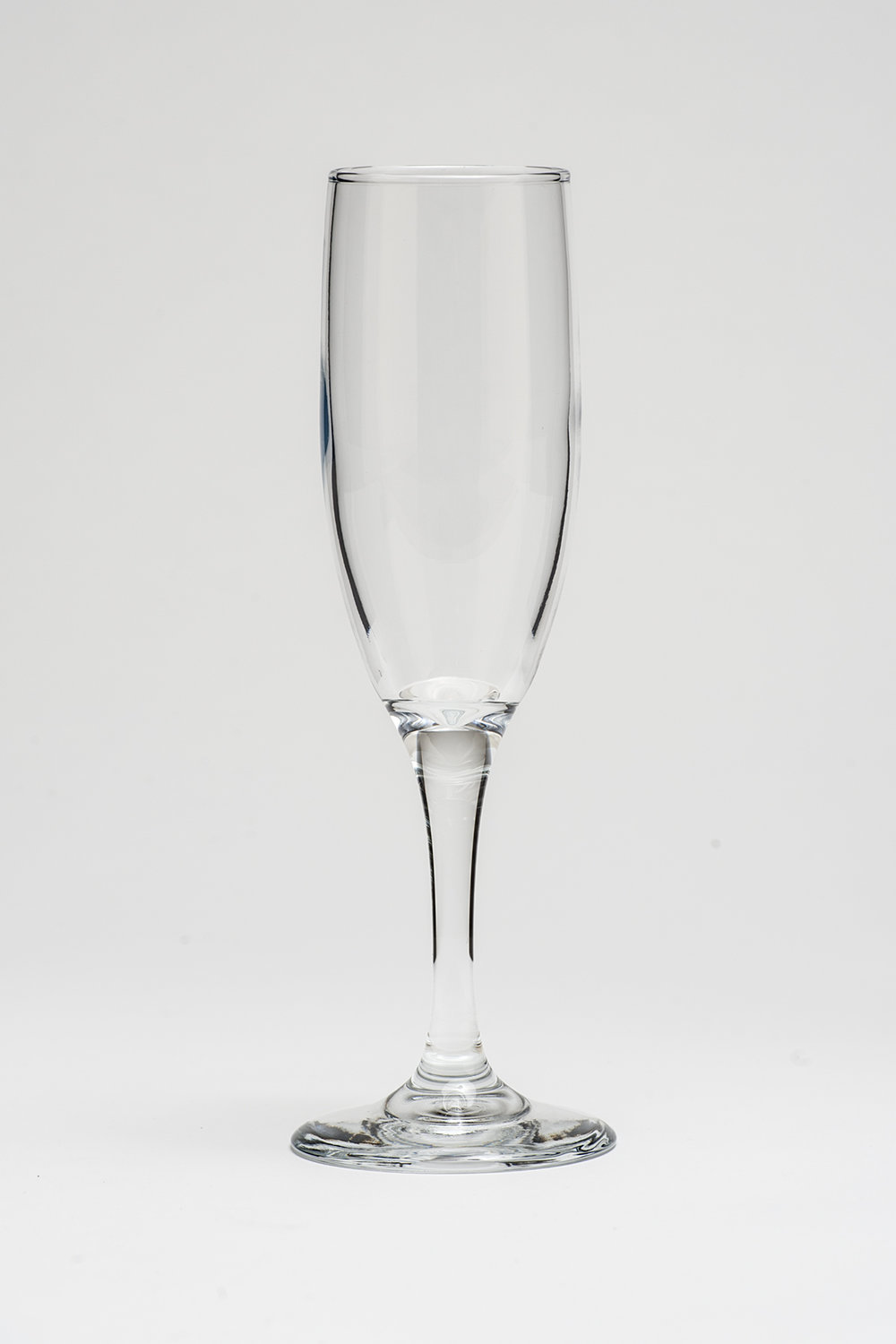 "Champagne Flute 7 oz.   Height 8""  Width 2""  $0.70"