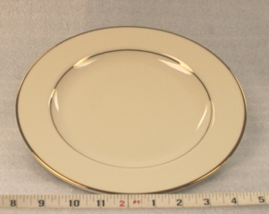 "Ivory and Gold Dinner Plate Height 1 1/4""  Width 10"" $0.70"