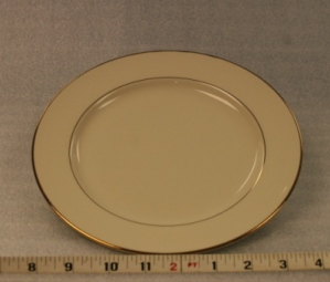 "Ivory and Gold Luncheon Plate   Height 1""  Width 9""  $0.70"